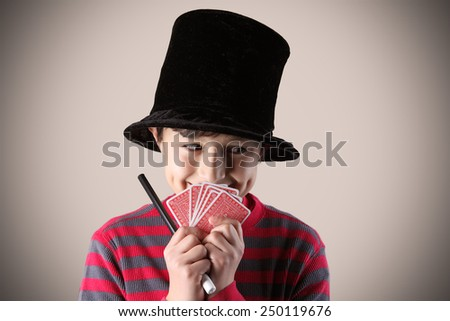 Young expressive magician with cards - with vintage colors and effects - stock photo