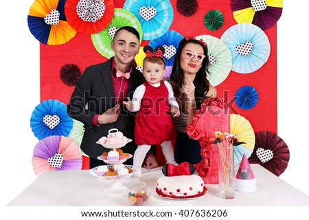 Young family celebrating the first day of the birth of daughter - stock photo