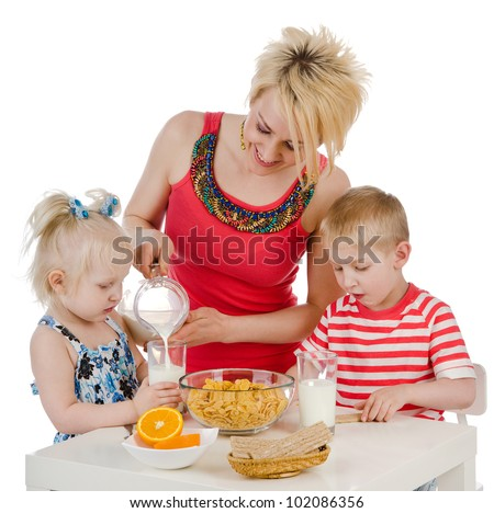 Young Family eating at a dining table. isolated on white background - stock photo