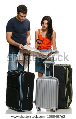 Young family going to vacations, choosing travel destination. Male and female standing with travel suitcases and looking at map, isolated on white background
