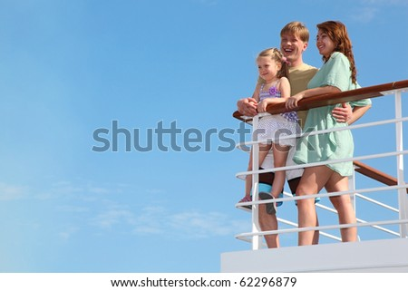 young family has summer leisure in cruise on motor ship - stock photo