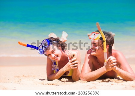 young family having fun at beach. remote tropical beaches and countries. travel concept - stock photo