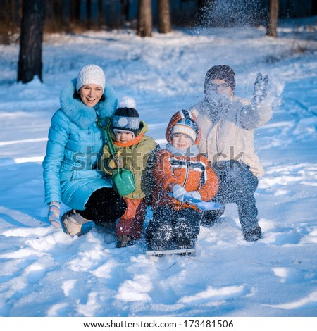 Young Family In Snow Scene - stock photo