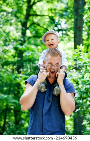 Young family in the park with their son - stock photo
