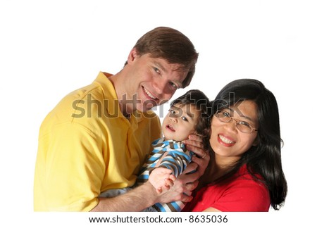 Young family isolated on white. Father is caucasian, mother is asian, multiethnic family. - stock photo