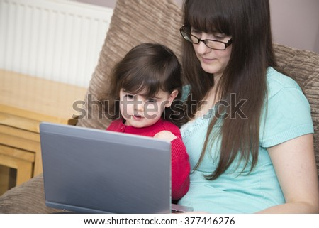 Young family looking on-line