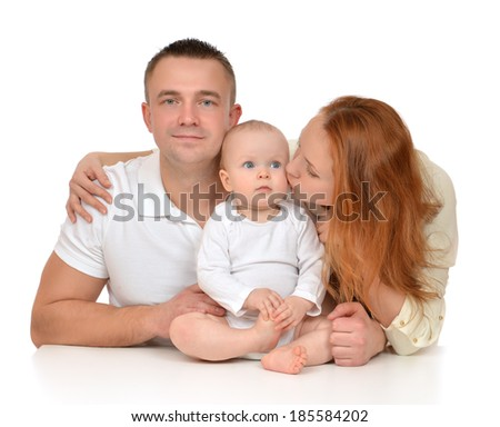 Young family mother and father with newborn child baby girl toddler isolated on a white background - stock photo