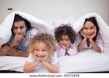 Young family playing in the bedroom