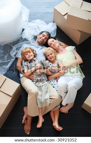 Young family sleeping in its new house - stock photo