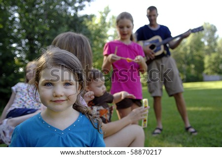 Young family spend some time playing in the backyard. - stock photo