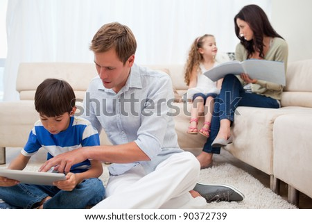 Young family spending spare time in the living room