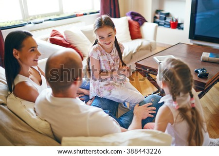 Young family spending their leisure time at home