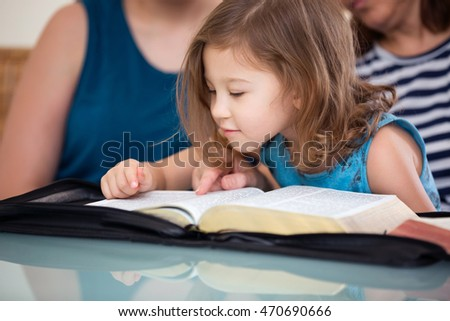 Young family studying the Word of God