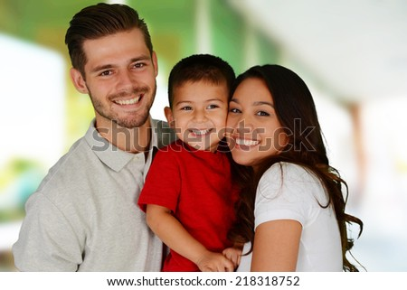 Young family together inside of their home - stock photo