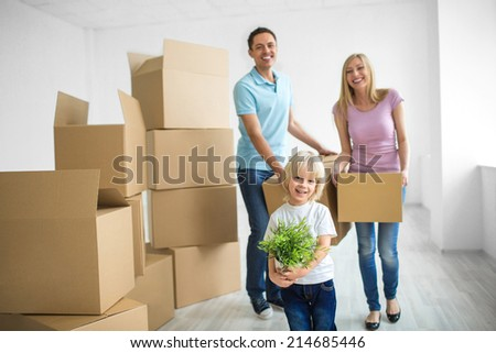 Young family with a child at home - stock photo
