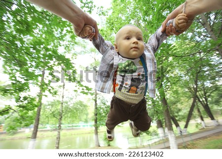 young family with a child in a summer park - stock photo