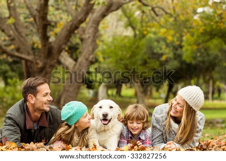 Young family with a dog on an autumns day - stock photo