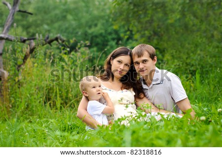 young family with a sun on the nature - stock photo