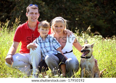 young family with dog - stock photo