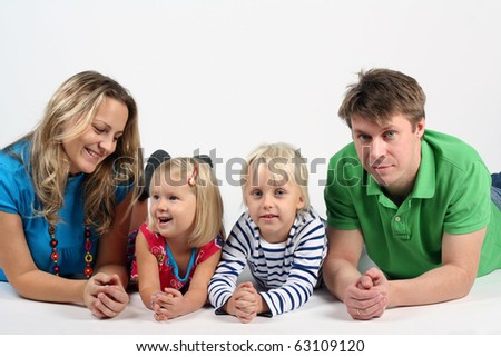 Young family with kids in studio - stock photo