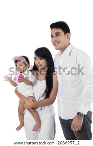 Young family with little baby isolated on white background - stock photo