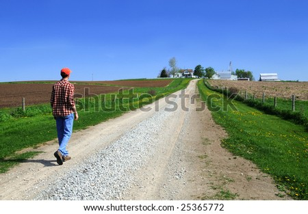 Young farmer going home - stock photo