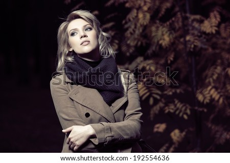 Young fashion blond woman in a night autumn forest - stock photo