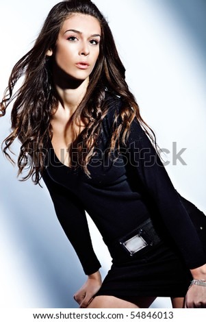 young fashion brunette woman  studio shot - stock photo