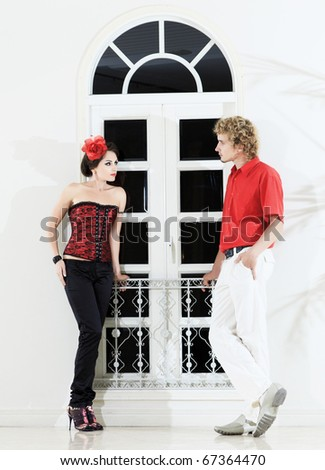 Young fashion couple near the window - stock photo