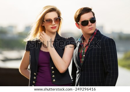 Young fashion couple on the city street