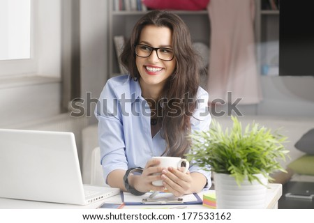 Young fashion designer working in her studio. - stock photo