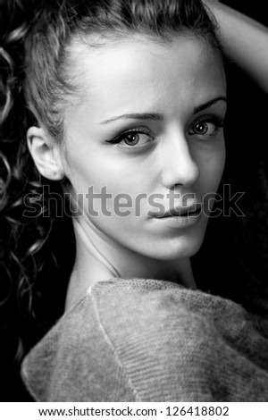 young fashion female model with long curly dark blond hair,head shot,portrait - stock photo