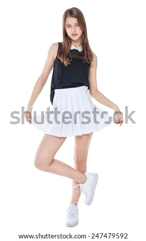 Young fashion girl in white skirt posing isolated - stock photo