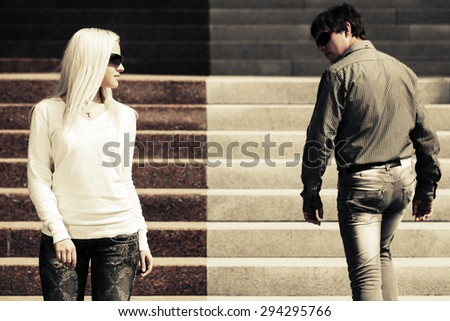 Young fashion man and woman on the steps