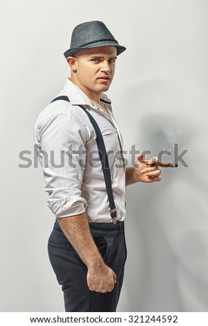 Young fashion man with cigar  - stock photo