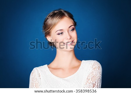 Young Fashion Model on Blue Background - stock photo