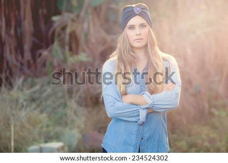 young fashion model posing with jeans in nature - stock photo