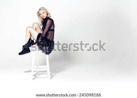 young fashion model  sitting on a chair - stock photo