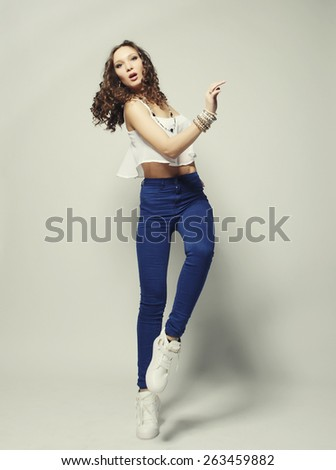 Young fashion model with curly hair