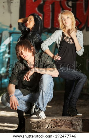 Young fashion people at abandoned apartment - stock photo