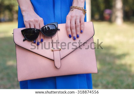 Young fashion woman hold handbag clutch - stock photo