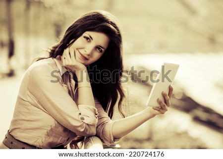 Young fashion woman holding a tablet computer  - stock photo
