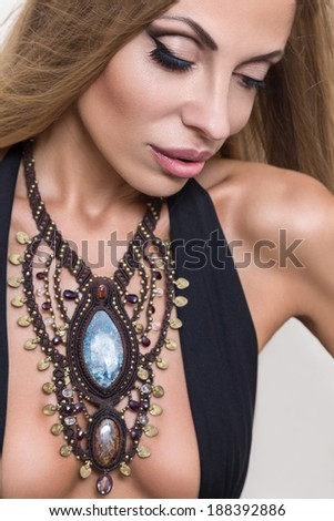 Young fashion woman posing with traditional indian jewellery - stock photo