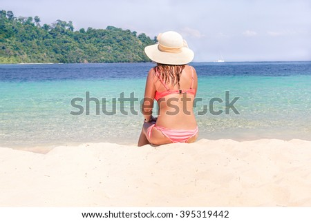 Young fashion woman relaxing on tropical beach during holidays in Thailand - Hipster girl sitting on white sand with paradise landscape nature view - Cruise and summer vacation concept - Warm filter