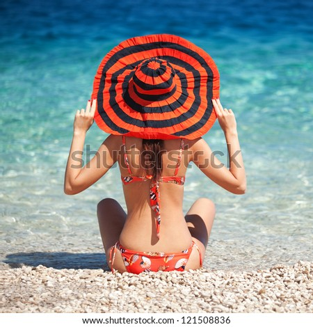 Young fashion woman rest on the beach - stock photo