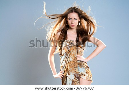 young fashion woman with long beautiful hair on the floor - stock photo
