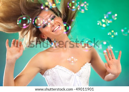 Young fashion woman with soap bubbles portrait. - stock photo