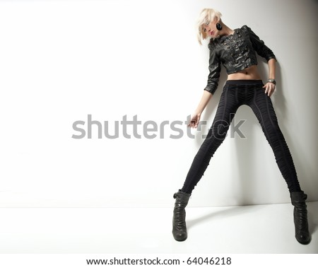Young fashionable beauty, lots of copy space - stock photo