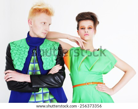 young fashionable couple posing at studio - stock photo