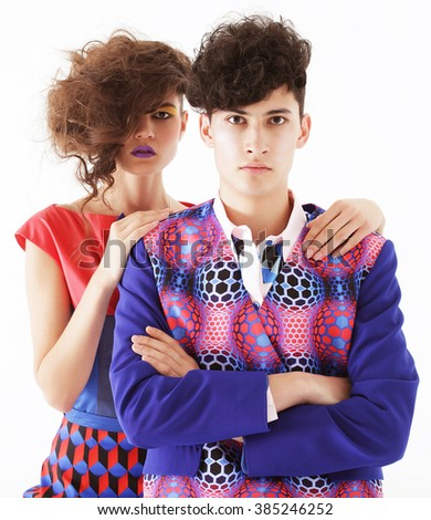 young fashionable couple posing at studio